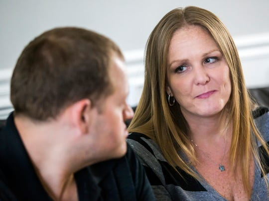 Sean and Janeen Feck discuss their adoption in their home in Wilmington on Monday Tuesday evening.