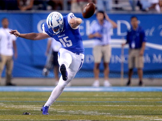 MTSU's Canon Rooker (15) punts against Alabama A&M