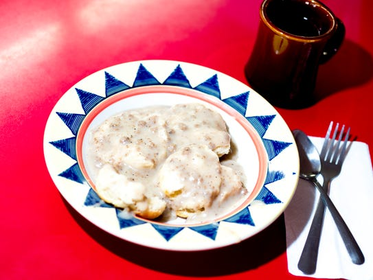 The biscuits and gravy breakfast is served with a coffee