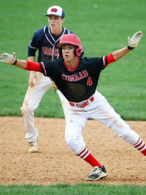 Conrad's Kyle Maxwell hops off second base as he takes a lead in the fourth inning of Conrad's 5-2 win against Newark Charter Saturday at Frawley Stadium.