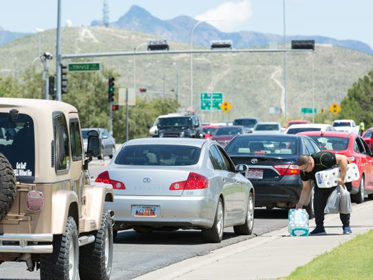 Some drop off people and items curbside along University Avenue on Saturday, August 12, 2017, during NMSU's Move-In Day. The traffic was heavier in the area because all freshman were mandated to live on campus this year.