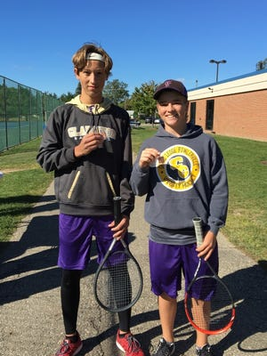 Caden Flanery (left) and Christian Montrose (right) were regional champions at four-doubles for the Fowlerville boys tennis team.