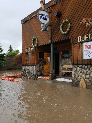 The Western Bar in Augusta on Main Street is surrounded by flood water Tuesday morning.