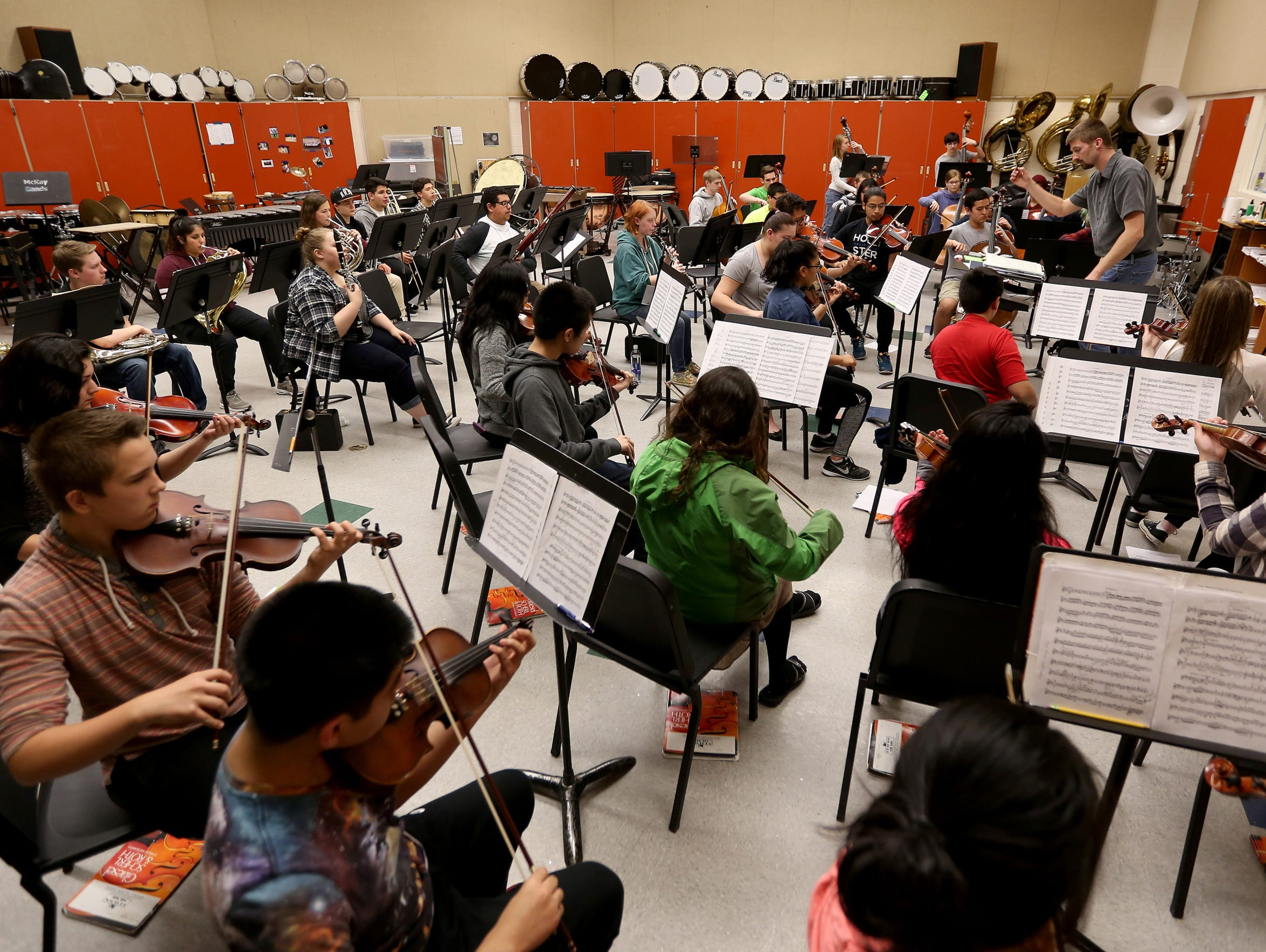 The McKay High School Symphony Orchestra rehearses