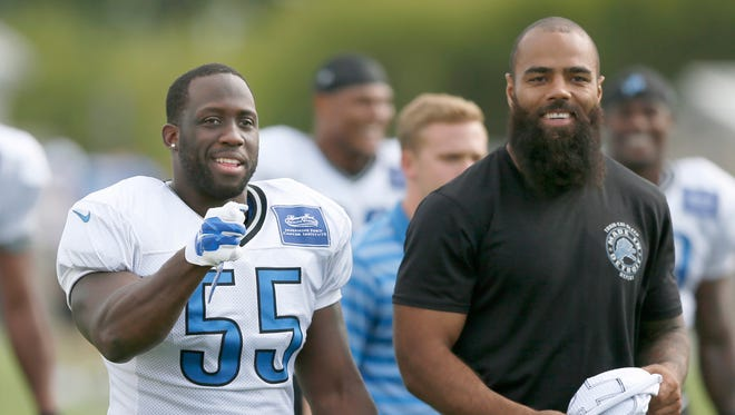 Detroit Lions linebacker DeAndre Levy, right, walks off the field after practice Aug. 7, 2015, in Allen Park.