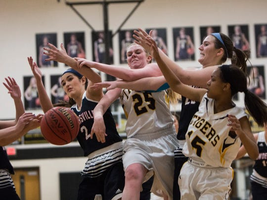 Powdersville's Jeanette Campbell (left) and Crescent's Kinsley Norris (center) fight for the rebound Wednesday in Starr.