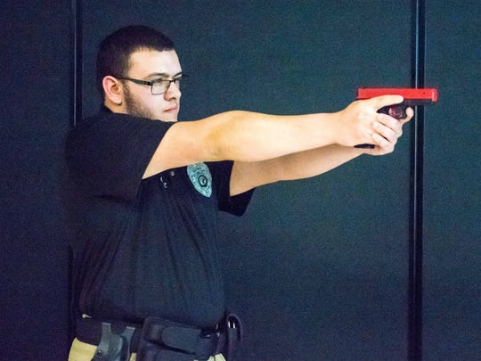 CCTEC Law Enforcement program senior Joshua Cruz demonstrates how to use Laser Shot during a police de-escalation exercise held at Cumberland County Technical  Educational Center on Thursday, March 30.
