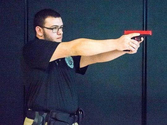 CCTEC Law Enforcement program senior Joshua Cruz demonstrates