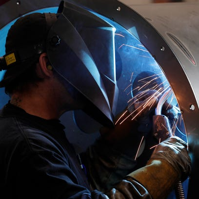 A welder works at American-3 Fab on Friday, June 15,