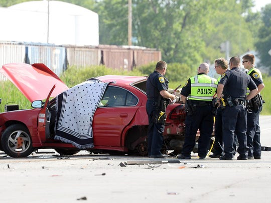 Green Bay Police work the scene of a multiple vehicle