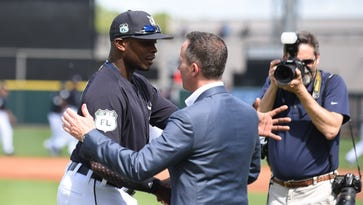 Chris Ilitch with Justin Upton, left, after the special ceremony to honor Tigers owner Mike Ilitch before the game.