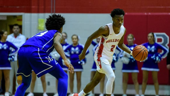 Mekhi Lairy, dribbling past Memorial's Dylan Penn (13) led Bosse to an 85-59 victory on Tuesday night. He scored 33 points to surpass Larry Weatherford, becoming Bosse's career scoring leader. Lairy is fourth on the City's career list.