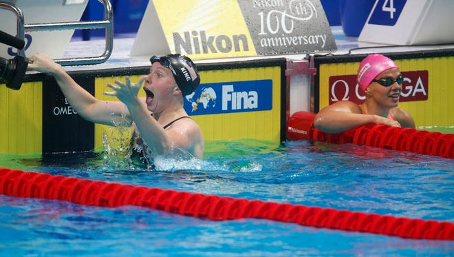 United States' Lilly King, left, celebrates after setting a new world record in the women's 100-meter breaststroke final as Russia's Yuliya Efimova, right, looks on during the swimming competitions of the World Aquatics Championships in Budapest, Hungary, Tuesday, July 25, 2017. (AP Photo/Darko Bandic)