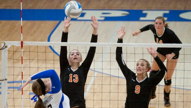 Armada senior Brittany Maxwell and junior Kelsey Gustafson attempt to block a spike from Cros-Lex senior Rachel Schadd during Tuesday night's volleyball matchup at Croswell-Lexington High School.