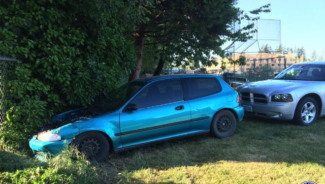 Colton McElroy, 20, of Salem, crashed his car into a fence near the Keizer Little League Park on Tuesday, May 10, 2016.