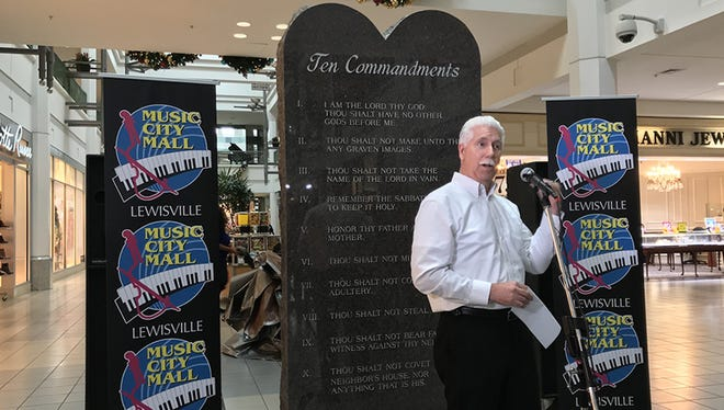 Music City Mall Lewisville General Manager Richard Morton unveils a stone tablet that displays the Ten Commandments on Dec. 29, 2017, in Lewisville, Texas.