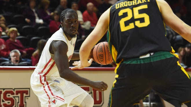 Marist's Khallid Hart looks for an open teammate during the Marist College men's basketball team's game against Vermont on Nov. 16.