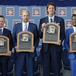Newly-inducted National Baseball Hall of Famers from left, Craig Biggio, John Smoltz, Randy Johnson and Pedro Martinez hold their plaques on Sunday in Cooperstown, N.Y.