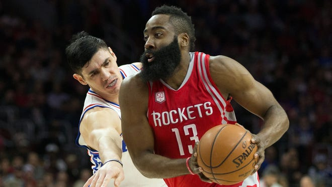 Rockets guard James Harden dribbles past Philadelphia 76ers forward Ersan Ilyasova during the first quarter at Wells Fargo Center.
