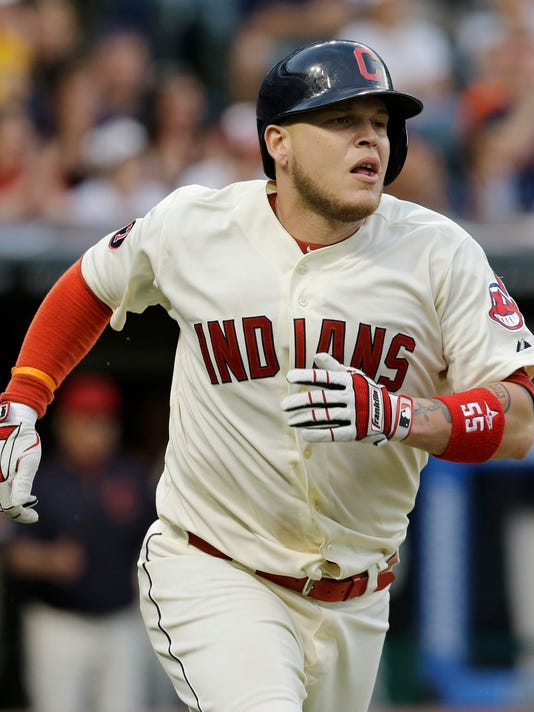 Cleveland Indians' Roberto Perez watches his RBI single off Oakland Athletics starting pitcher Chris Bassitt during the seventh inning of a baseball game, Saturday, July 11, 2015, in Cleveland. (AP Photo/Tony Dejak)