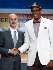 Myles Turner, right, poses for photos with NBA Commissioner