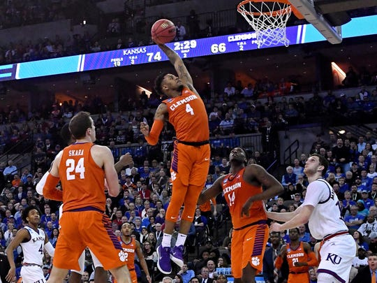 Clemson guard Shelton Mitchell (4) rises up for a one-handed flush during the second half against Kansas.