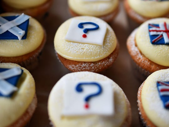 """""""Referendum cupcakes"""" featuring a Scottish Saltire flag (left), the U.K.'s Union Jack flag and a question mark are pictured in a bakery in Edinburgh, Scotland."""