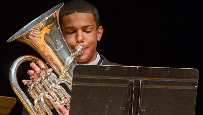 """Great Falls High student Keandre Hairston works through the euphonium part during his ensemble performance with """"Smooth Caramel and the Boys"""" at the 2015 MHSA District 6 Music Festival."""