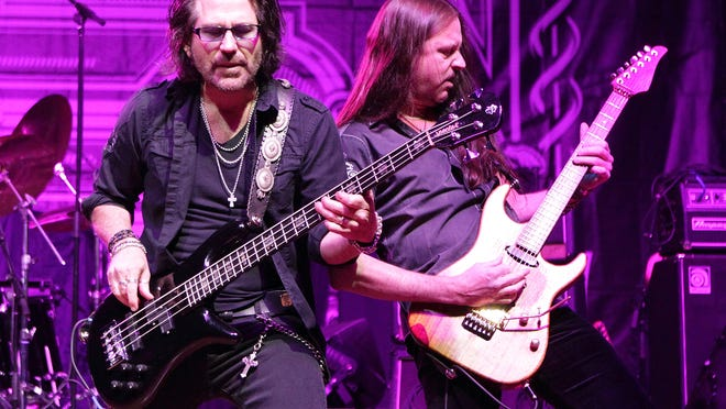 Kip Winger and Reb Beach of the rock band Winger perform April 25 during the M3 Rock Fest at Merriweather Post Pavilion in Columbia, Md.