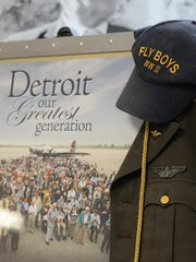 """A display of World War II memorabilia from the documentary """"Detroit the Greatest Generation."""""""