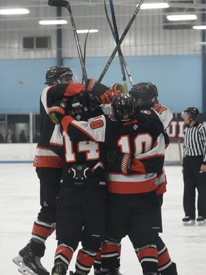 Brother Rice players celebrate the first goal of the game credited to Nick Marone (10).