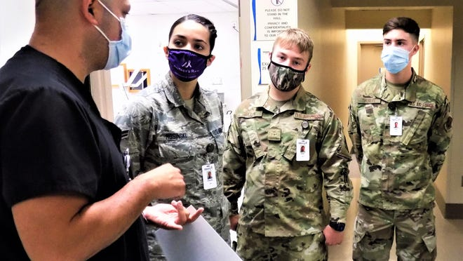 Sergio Raygoza, supervisor of emergency services at Mercy Fort Smith, left, speaks with 188th medics Priscilla Mosinski, Elijah Hardin and Luke Thurlby on June 26 in the Mercy Fort Smith Emergency Department. Members of the 188th Medical Group were on a walk-through in preparation for a training program with Mercy, which got underway on June 29.