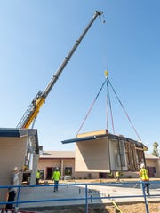 A crane was used Tuesday, July 17, 2018 to place modular