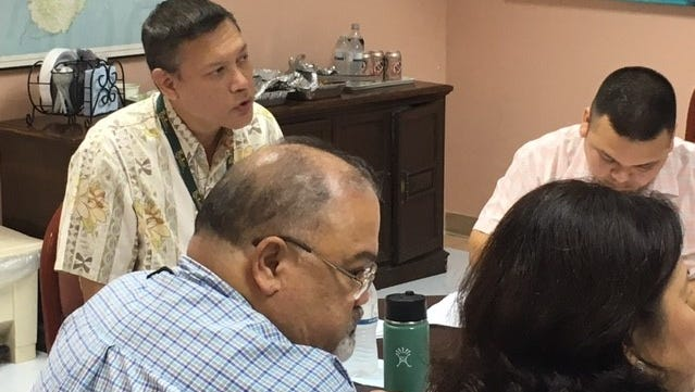 Guam Memorial Hospital Authority board chairman Eloy Lizama, left, hospital Administrator PeterJohn Camacho, center, and hospital Chief Financial Officer Benita Manglona, right, attend Thursday evening's board meeting at the hospital's conference room