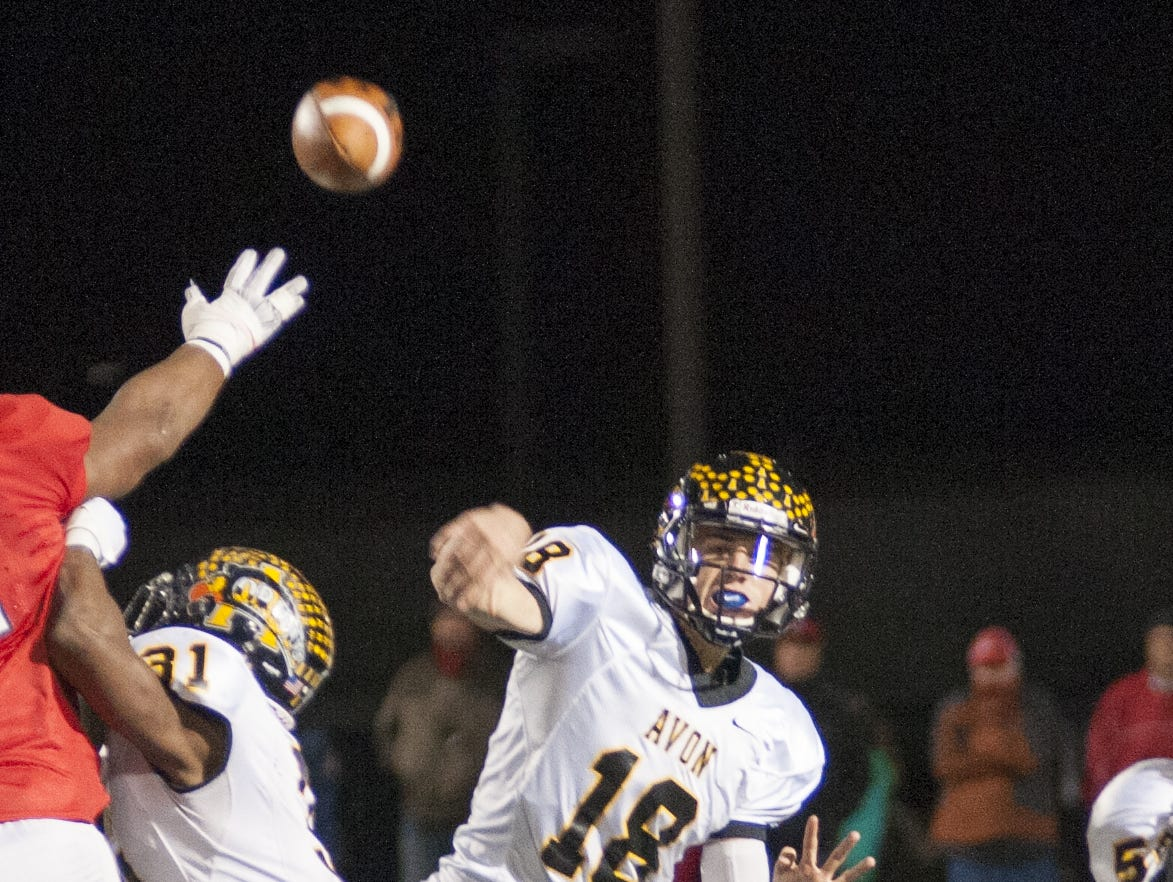 Avon quarterback Brandon Peters (18) throws a pass Friday, Nov. 13, 2015, against Center Grove during the Class 6A semi-state playoff game.