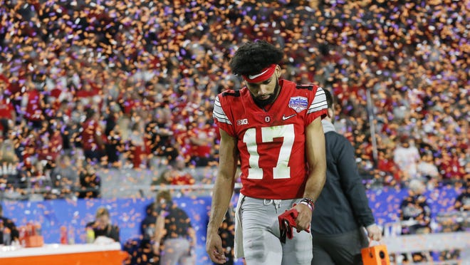 """Receiver Chris Olave walks off the field following the College Football Playoff semifinal loss to Clemson on Dec. 28. Coach Ryan Day said the Buckeyes """"really, really wanted"""" to return to the playoffs this year after last season's disappointing end."""