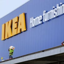 June 22, 2016 - Construction works work on roofing material above the exit of the IKEA under construction in Memphis.
