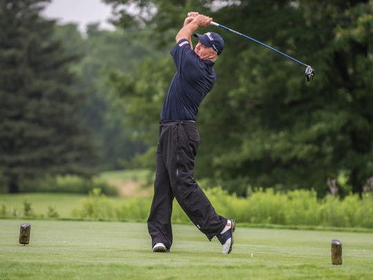 Battle Creek's Ron Osborne hits a drive shot during the first day of the Senior Open at Bedford Valley.