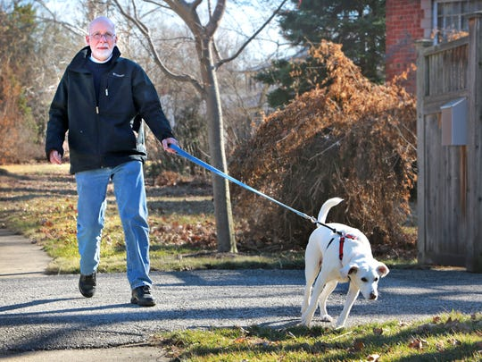 Bill Foley and his faithful dog Sophie on one of their daily walks in the Warfleigh neighborhood near Broad Ripple, Foley is a Pulitzer Prize winning photojournalist and is an assitant professor of Fine Arts at Marian College. The Indiana State Museum will be opening a new exhibit March 28 titled, Art Meets News: The Work of Photojournalist Bill Foley.