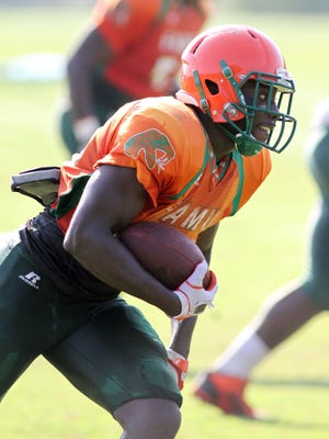 Vasty Paul, shown playing running back in Saturday's scrimmage, spent the last two seasons as a defensive back.