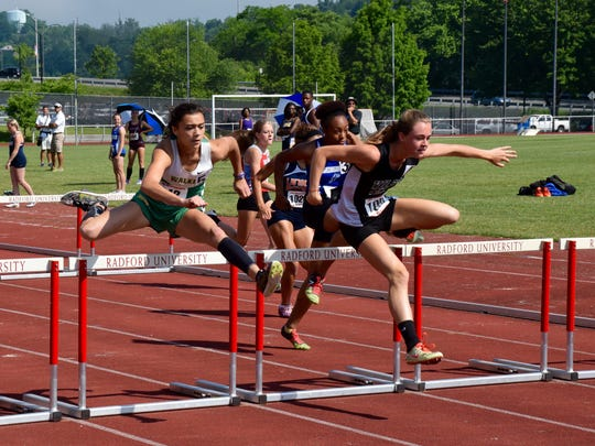 Wilson Memorial's Emilie Miller, right, clears a hurdle to stay ahead of Maggie Walker's Shanthi Hiremath during the girls 100-meter hurdles at the Group 2A meet on Saturday, June 4, 2016, at Radford University. Miller held on to win the race and the state title.