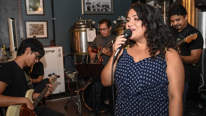 Shannon McManus and Jonathan Glaser, front and left respectively, participate in a jazz performance at the Mermaid Tavern and Grille in Hagåtña on July 2. McManus and Glaser, originally from Guam, are visiting as members of the Los Angeles-based band, Paluma.