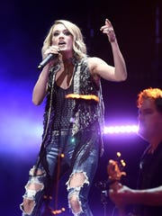 Carrie Underwood performs at the 2016 CMA Music Festival in Nashville.