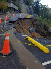 Heavy rains Oct. 23 caused a serious road collapse at the upper parking lot at the attraction at Chimney Rock State Park. The park is closed until further notice.