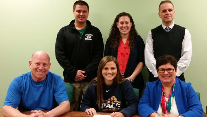 Brewster girls lacrosse player Mary Kate Lonegan, center of the bottom row, prepares to sign her national letter on intent with Pace University at Brewster High School on Thursday, April 14th, 2016.