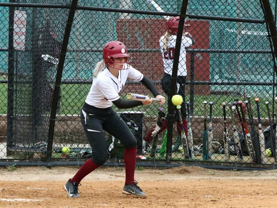 Bloomfield sophomore pitcher Lexi Corio bunting in