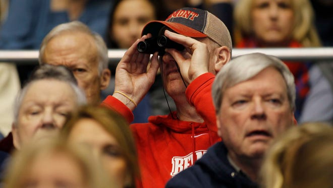 Because of his failing eyesight, David Bradds has to use binoculars to watch his son, Belmont star Evan Bradds, play basketball.