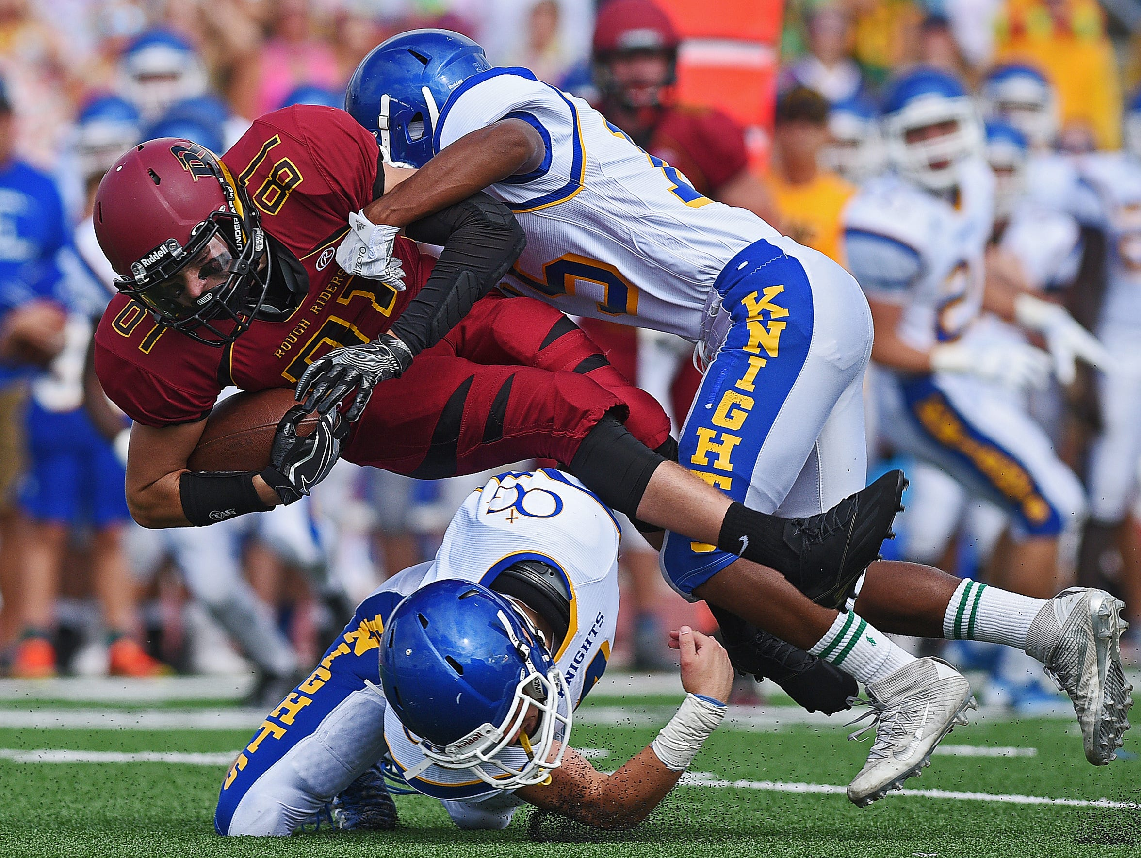 Roosevelt's Austin Johnson (81) is brought down by