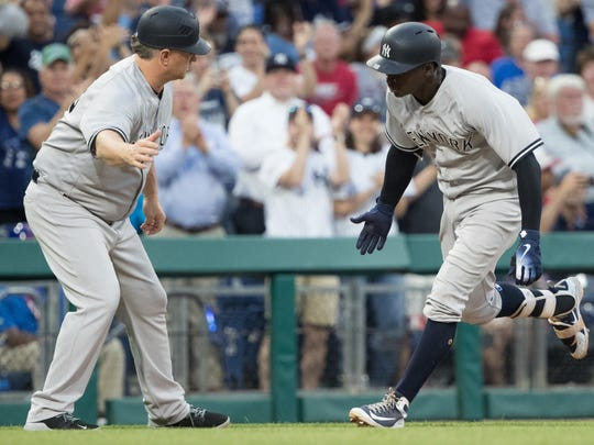 New York Yankees shortstop Didi Gregorius (18) celebrates with third base coach Phil Nevin (53) after hitting a home run during the fifth inning against the Philadelphia Phillies at Citizens Bank Park.