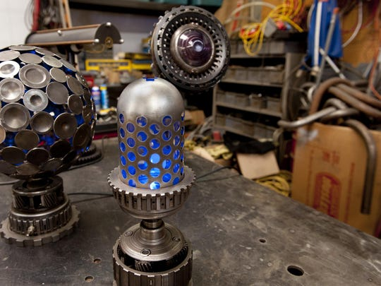 Machine Brothers Mark Leonard and Dan Strode create machine age pieces from recycled and donated parts. Photo taken on Tuesday, May 26, 2015.